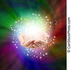 Magical Moment - Female cupped hands emerging from a...