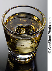Scotch on the rocks on a grey background with reflection