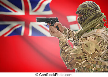 Male in muslim keffiyeh with gun in hand and Canadian...