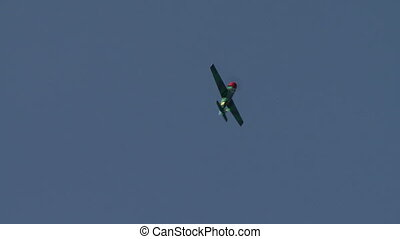 View of plane performs aerobatics loop - View of...