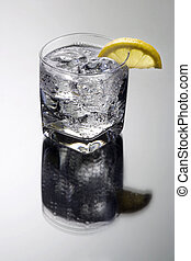 Club Soda or Gin / Vodka Tonic Cocktail on a grey background...