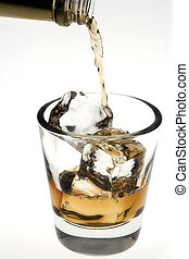 Whiskey being poured over ice cubes on a white background
