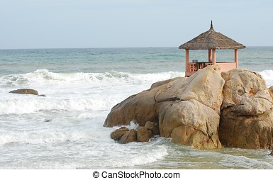 The gazebo restaurant on a huge boulder by the sea. Vietnam,...