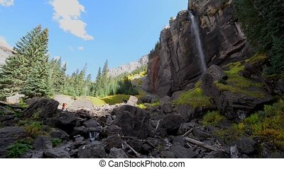 Bridal Veil Falls Telluride Colorado USA - Girl taking...