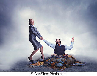 Business help - Businesswoman helps businessman to get out...