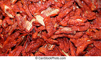 red tomatoes dried in the market - many red tomatoes dried...