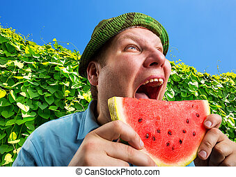 Bizarre man eating watermelon