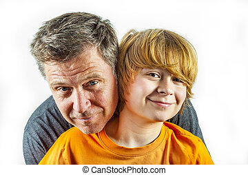 father and happy son hugging - portrait of father and happy...