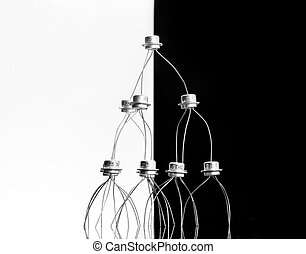 Concept of transistors acrobats pyramid on black and white