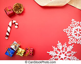 Gifts on red - White snowflake holiday decoration close...