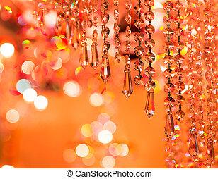 Vintage crystal lamp details, orange tone