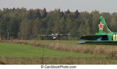 Aerodrome. Twin-engine plane lifted into air - Aerodrome....
