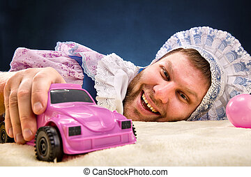Man weared as baby with car - Man weared as baby with toy...