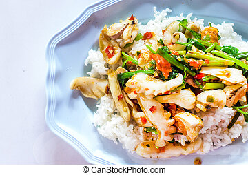 stir fried squid with chilli and basil on blue plate