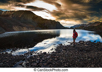 Hiker near Crystal Lake at Sunset Ophir Pass Colorado -...