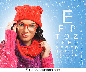 Beautiful woman with red scarf, hat and glasses over test...