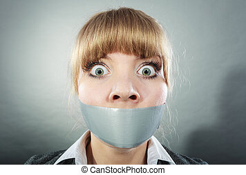 Scared woman with mouth taped shut. Censorship. - Scared...