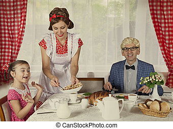 Vintage styled family have breakfast at home Monochrome,...