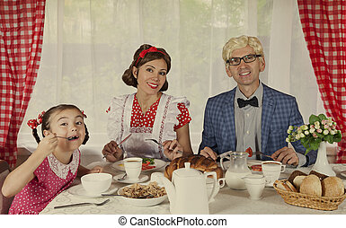 Retro styled family have breakfast - Retro styled family...