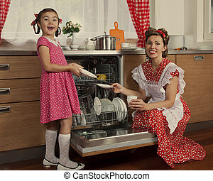 Mother with her daughter in a kitchen - Retro styled mother...
