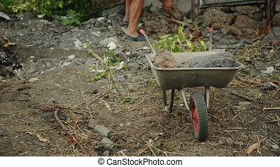 Man Gathering Building Materials in a Cart - Rural worker...