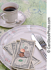 gratuity - money on the dinner plate for the service tip