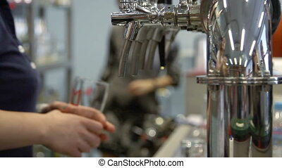 Barman pulling a pint of beer behind the bar