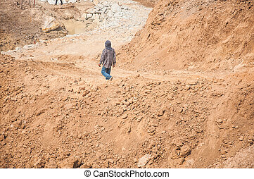 sand quarry : building site man working on ground