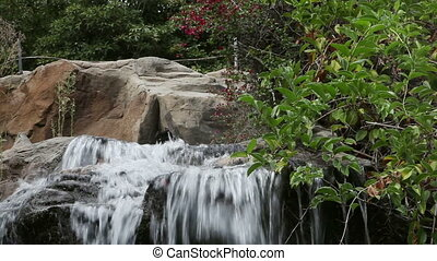 Beautiful waterfall. Water cascading down - Beautiful...