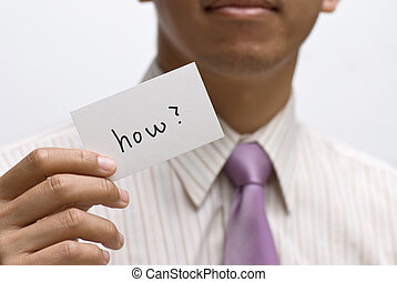 how - How card holding by businessman on white background.