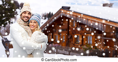 smiling couple in winter clothes hugging outdoors - winter,...