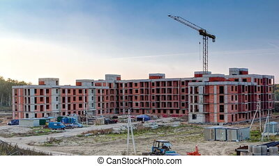 Tower cranes build large residential building in Moscow...