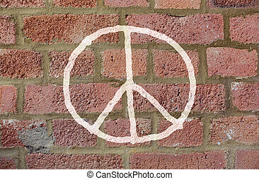 peace sign drawing on red brick wall - symbolic, pacifism...