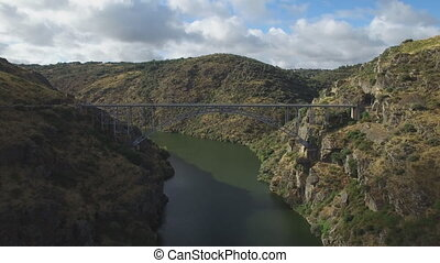 Fast aerial view of iron bridge over canyon in Zamora, Spain...