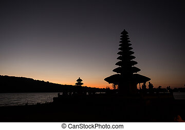 Pura Ulun Danu temple silhouette before sunrise on a lake...
