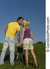 couple - beautiful couple kissing on a green meadow