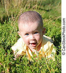 happy smiling baby in grass