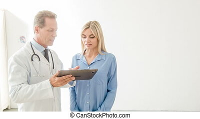 Physician is using his portable tablet - Appointment in...