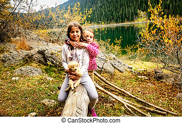 Two little girls hiking on Black Lake ( Crno...