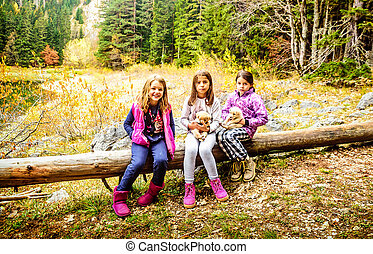 Group of female shool friends hiking on Black Lake Crno...