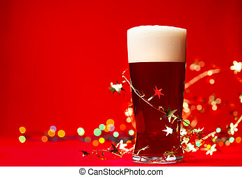 Christmas beer - Full glass of bear or ale with tinsel and...