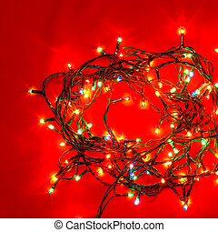 Christmas lights on red - Christmas lights of different...