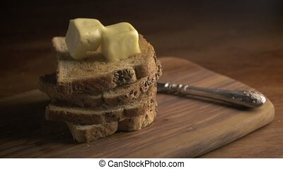 Stack of bread slices and melting butter