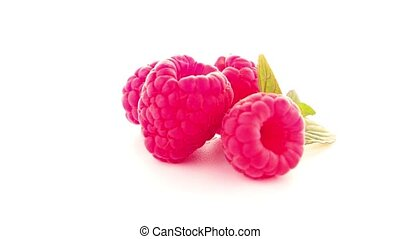 Ripe raspberry with leaf isolated on white background