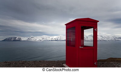 Timelapse Iceland red phone booth - Timelapse tilt shot of a...