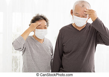 senior couple with protective face mask