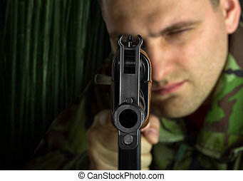 Soldier with rifle AK-47 aiming to you