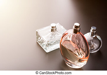 Three bottles of perfumes. Toned image