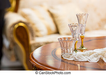 Tree small liqueur glasses on the table in the room