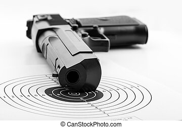 Paper target and pistol on white - Paper target and airgun...
